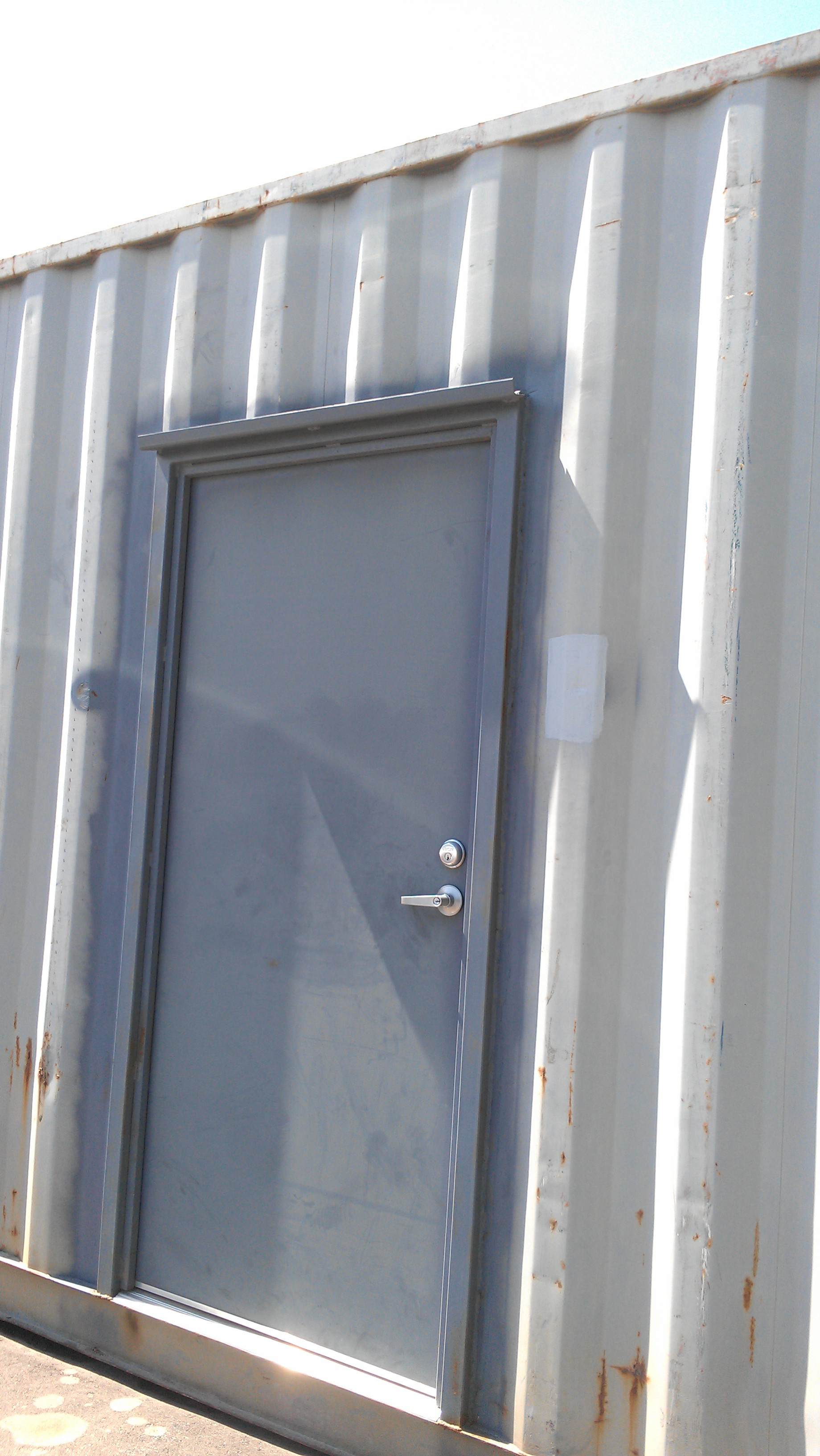 Man-door installed on container