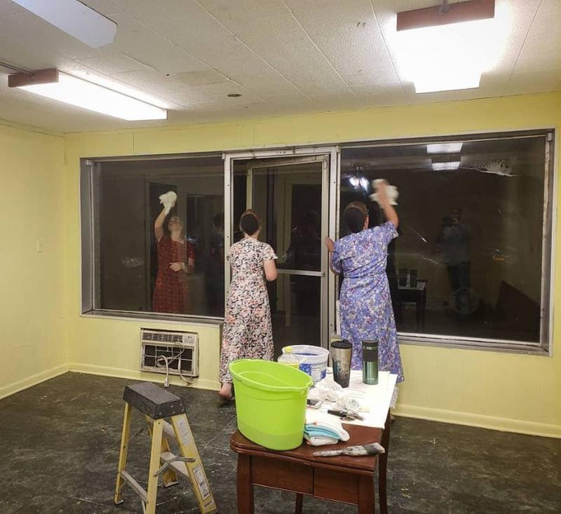 Members of the local Mennonite youth group help paint and clean the new Learning Center