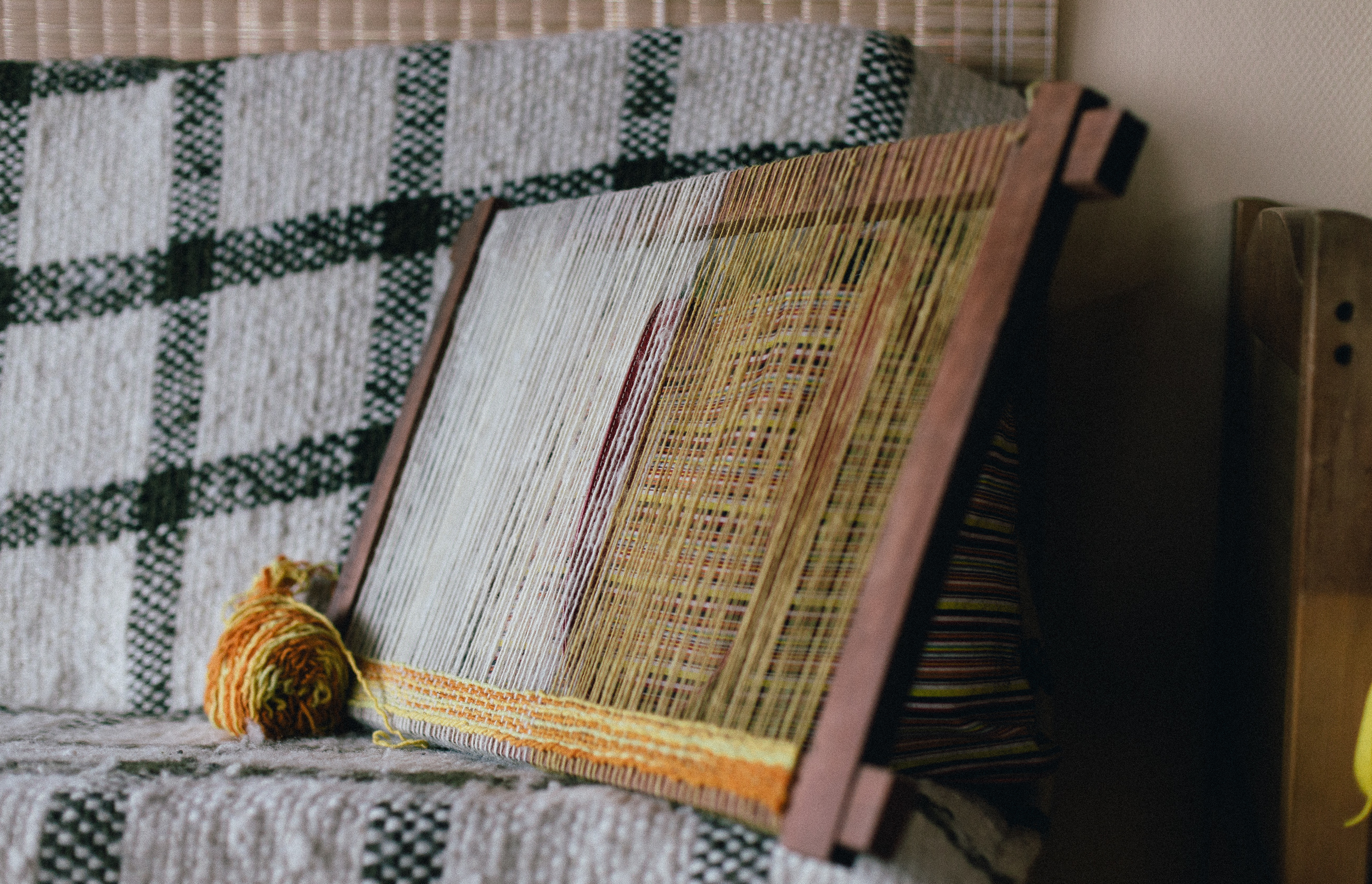 The beginning of one of Grecia's traditional weaving pieces using hand dyed locally produced wool from natural materials, in this case, onion.  Alihuen, Chiloe.