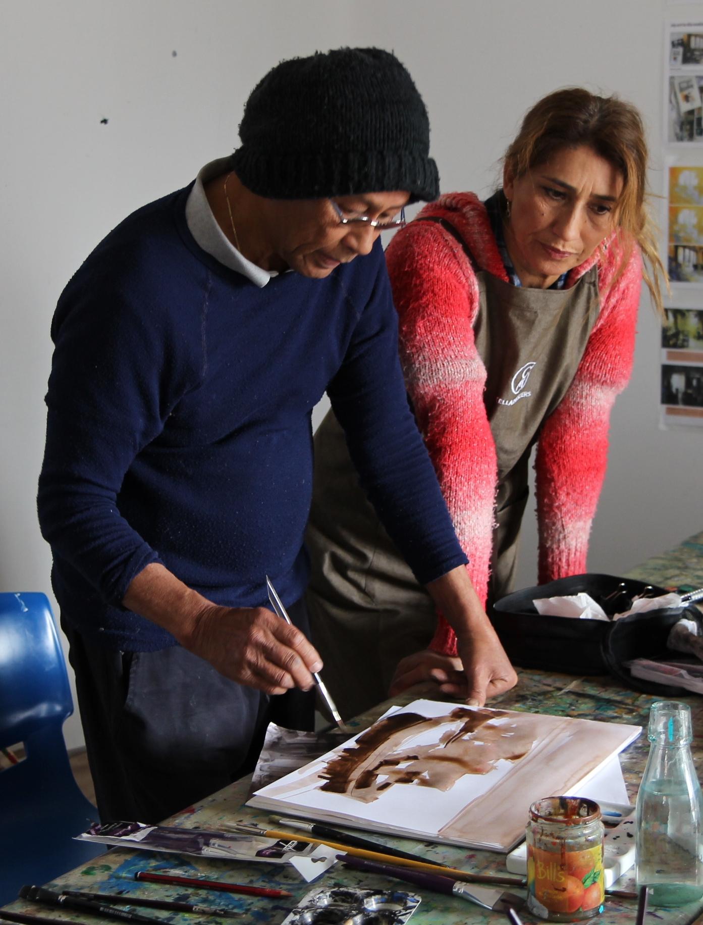 Tutor Ian de Souza, left, has works featured in the exhibition.