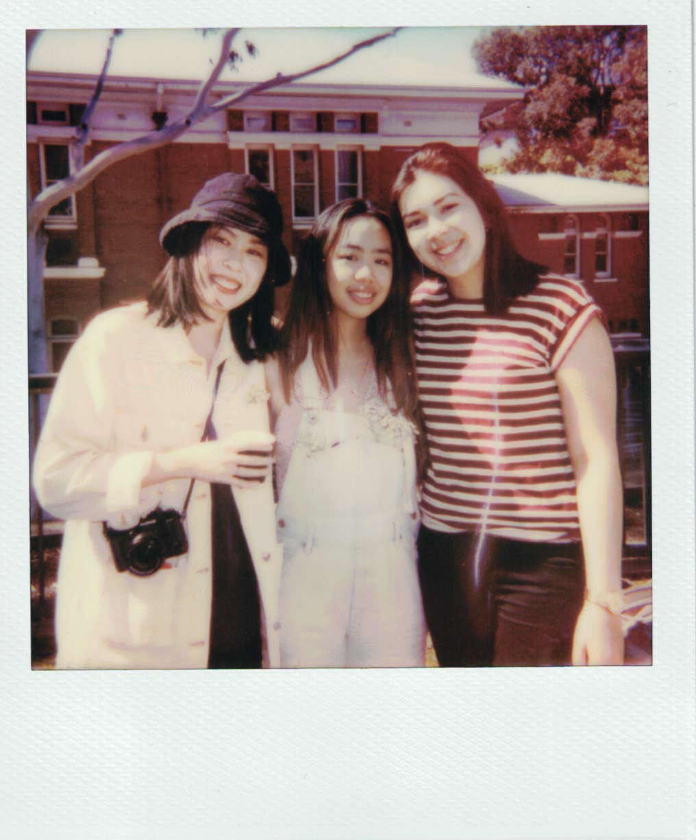 From left to right: Yoshika, Ria and Cecile. Taken on Ria's Polaroid at the Creatives Picnic.