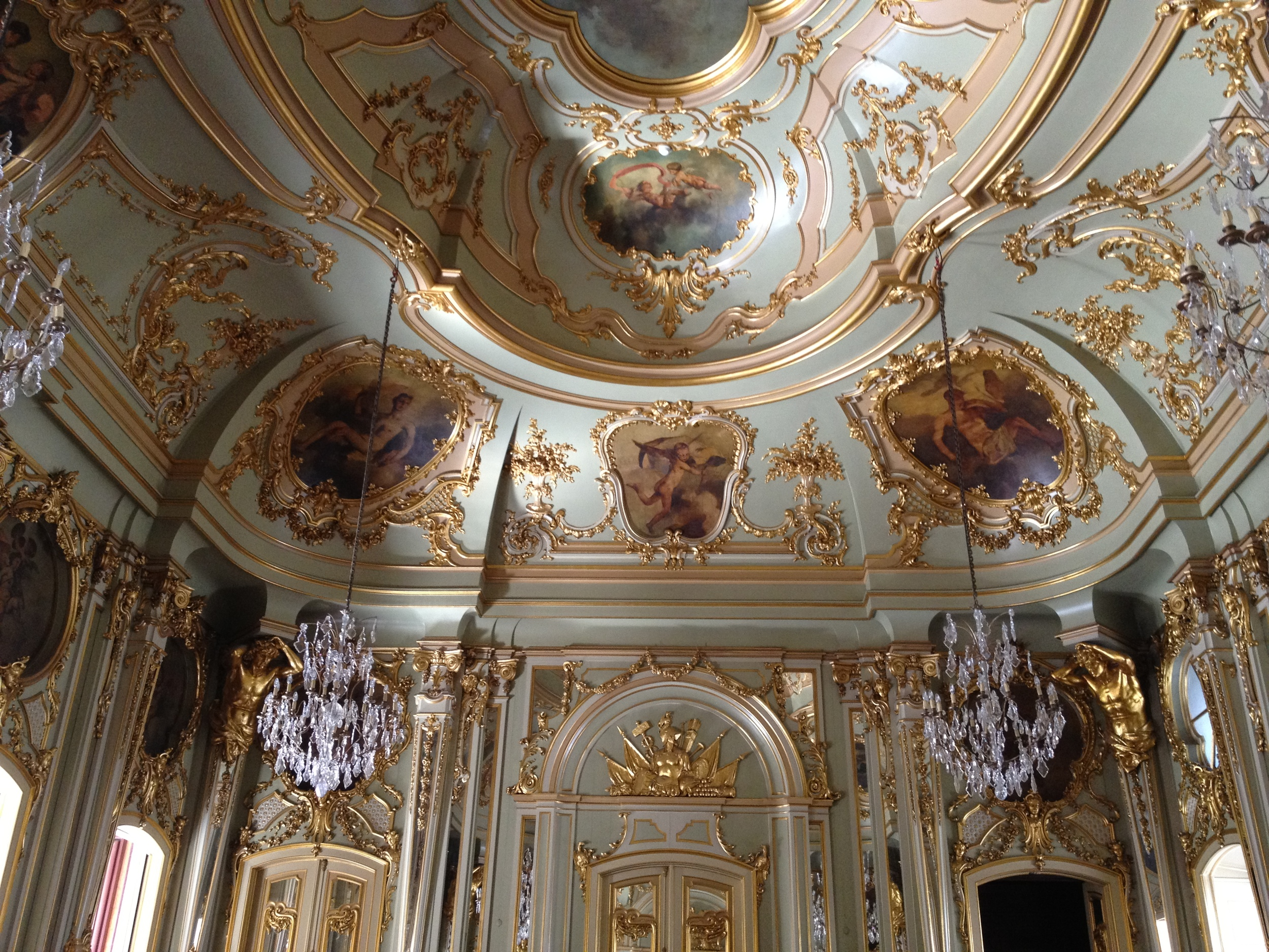 TheSoft pastels of the paint work contrast to the gilded frames and organic motifs of the decorative works. There were mirrors on every wall. When the afternoon sun came through the balcony doors, the entire room was bathed in a really soft golden glow. Gorgeous!
