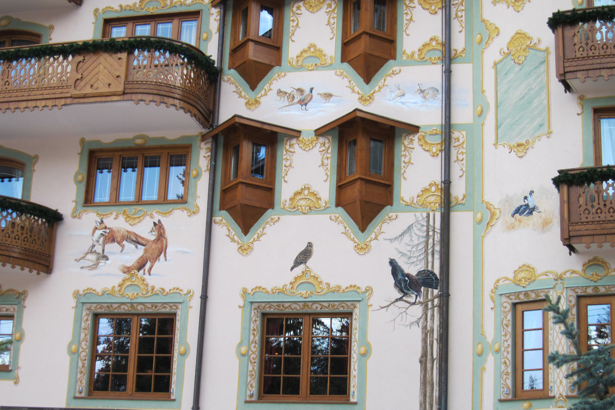 A Closer image of the Austrian Chalet.  The exterior paintings of foxes and game birds make it's purpose as a hunting lodge quite obvious.
