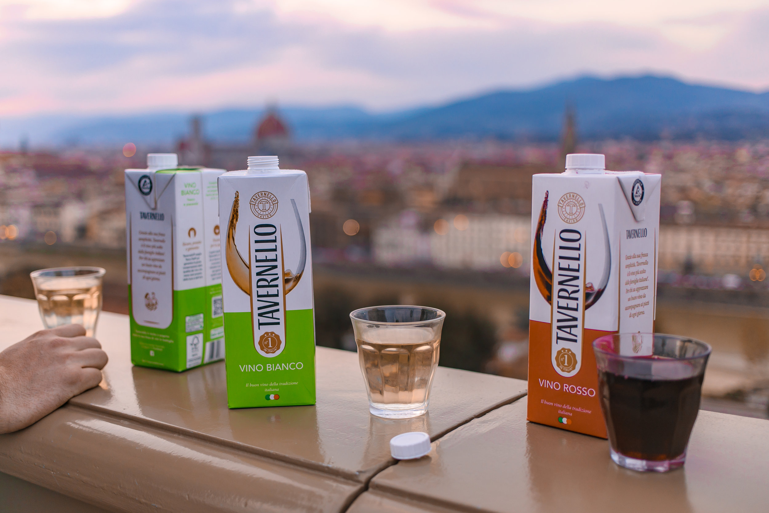 Watching the sunset with snacks and drinks at Piazzale Michelangelo, one of the best things to do in Florence!