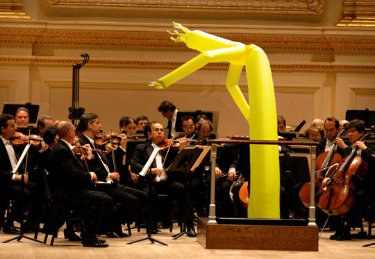 A conductor is only useful for two things:   either they're going to make the ensemble play better; or they're a superstar and can sell tickets. Otherwise they're a useless wand-waver. A lot of the time an orchestra plays perfectly fine without a conductor (  not with heavy scores, like  Heldenleben , where balance is critical).   Take  ACO  and their Surfie-In-Chief, for example, sometimes playing and sometimes head bobbing. If the direction is coming from the leaders inside the ensemble, this gives an opportunity for the sheep to become wolves, or at least to become fire-breathing sheep with cool dragon wings.