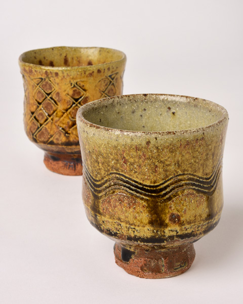 Jim-Malone_Pair-of-Yunomi_with-river-iron-granite-and-ash-glazes_2.jpg