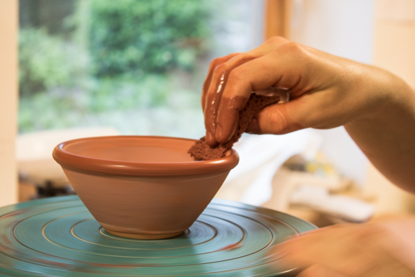 Smoothing the rim on a standard ware bowl