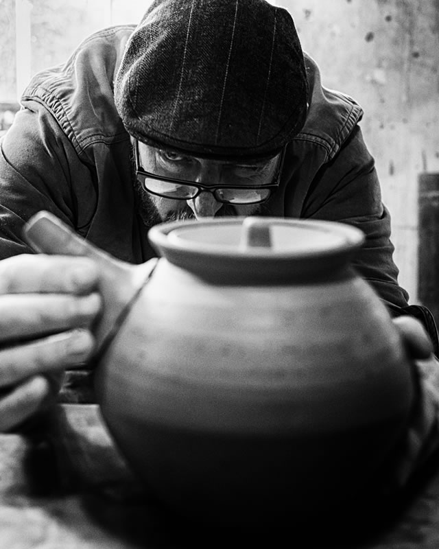 Roelof Uys aligning the spout on a teapot