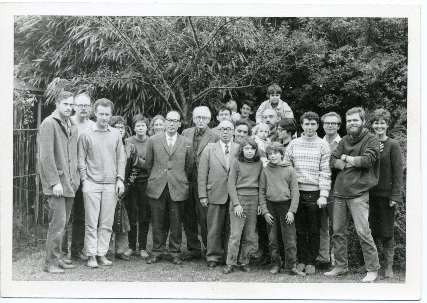 At the Leach Pottery, 1963. Left to right: Ian Steele, Warren MacKenzie, Michael Henry, unknown, Pat Ashmore, Jean Vinicombe, Shinsaku Hamada, Bernard Leach, Shoji Hamada, Bill Marshall, Scott Marshall, Janet Leach, Warren MacKenzie