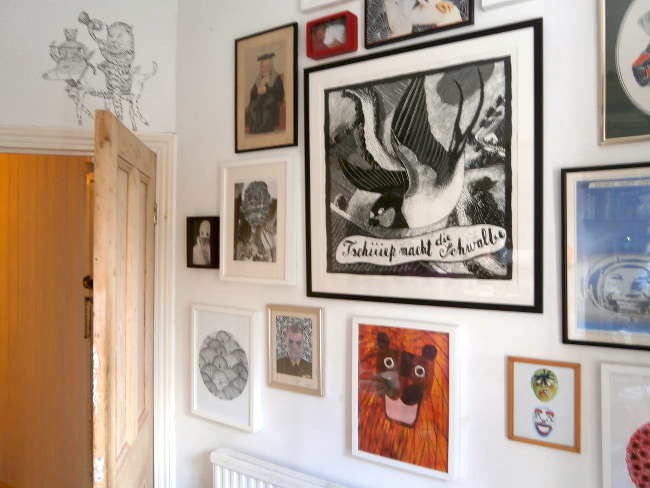Jamie's living room - where he works when not at his studio in Crystal Palace - is packed full of an eclectic mix of framed pictures, many of his own work, the very frames creating another kind of pattern on the wall itself.