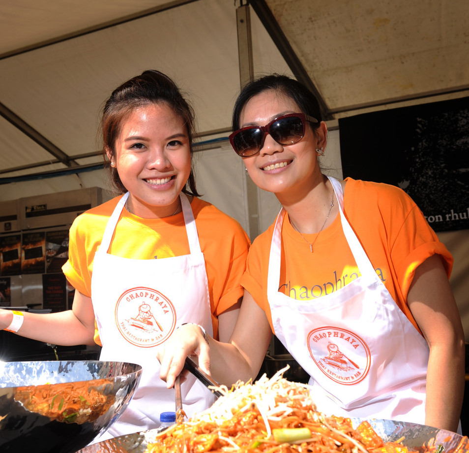 6 June 2014.......  Chutipa Hansahiranvadee and Suratsawadee Thaikamnoed from Chapraya Thai at the Yorkshire Food and Drink Show in Millennium Square, Leeds. TJ100389g Picture by Tony Johnson