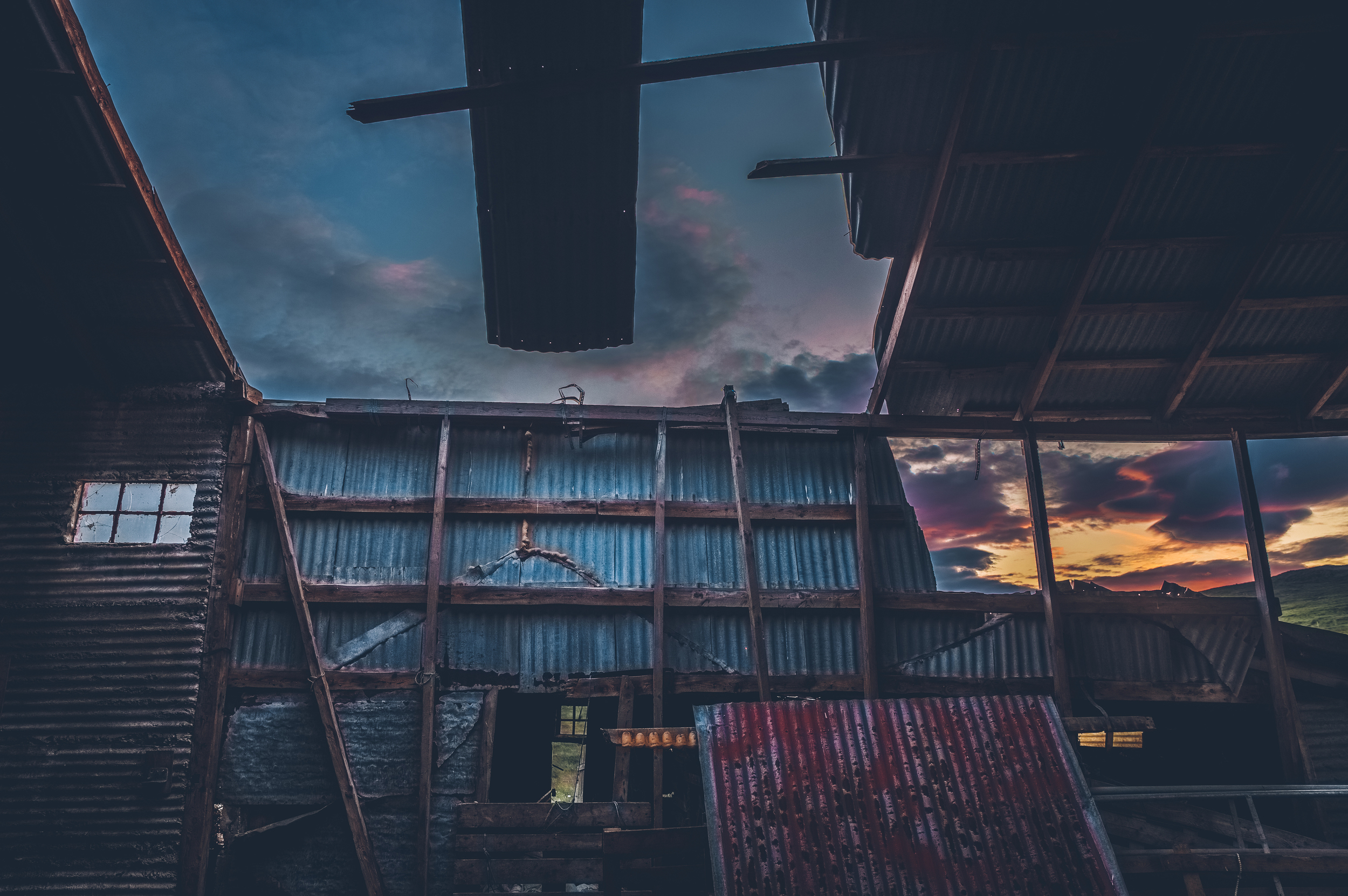 Sunset through an abandoned farm shed in Reykholt.jpg