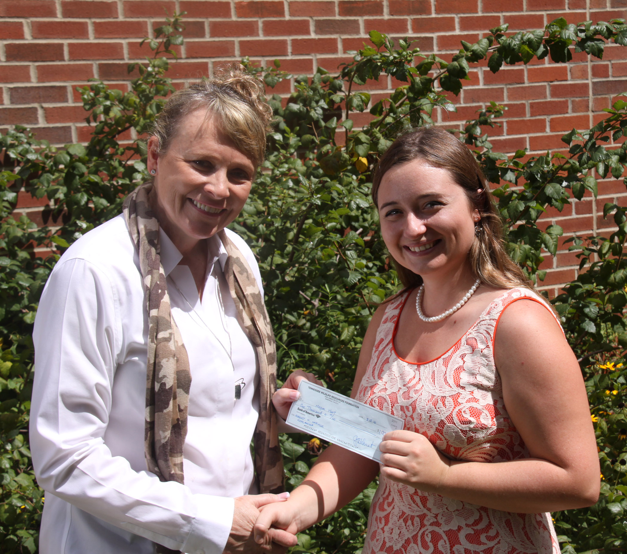 TWRF Executive Director, Julie Schuster, presents the scholarship check to Megan Hart.