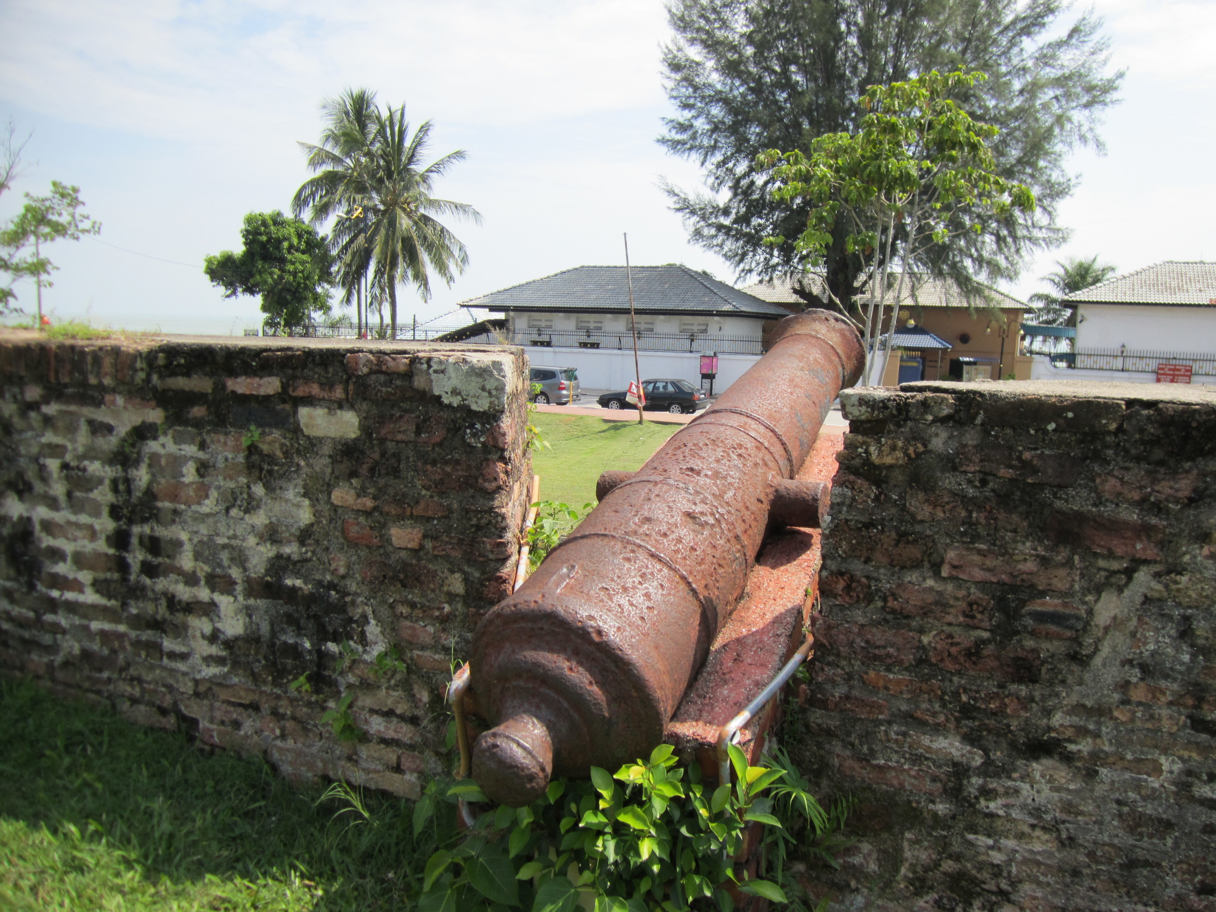 An 18th century cannon looks out protectively from Fort Cornwallis in Penang, Malaysia.  Tour the fort along with other amazing sites when you visit.