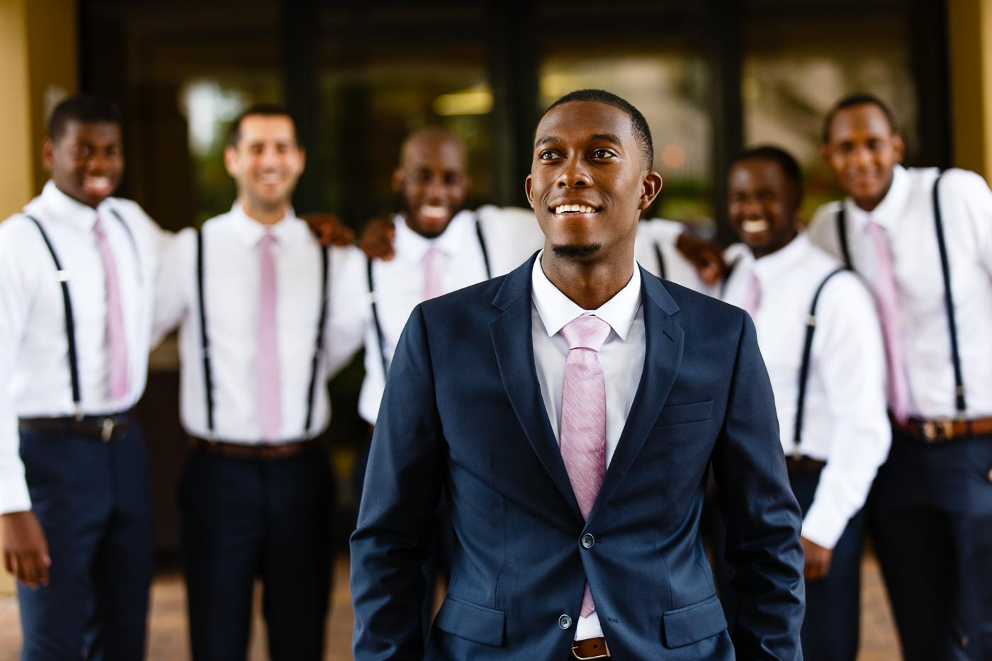 hilton orlando wedding groom smiling tuxedo suit