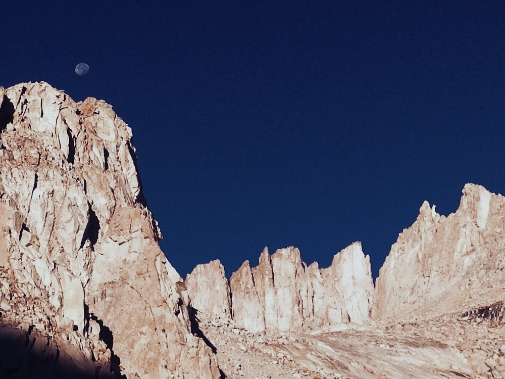 Mount Whitney and its neighboring crags, with the setting moon.