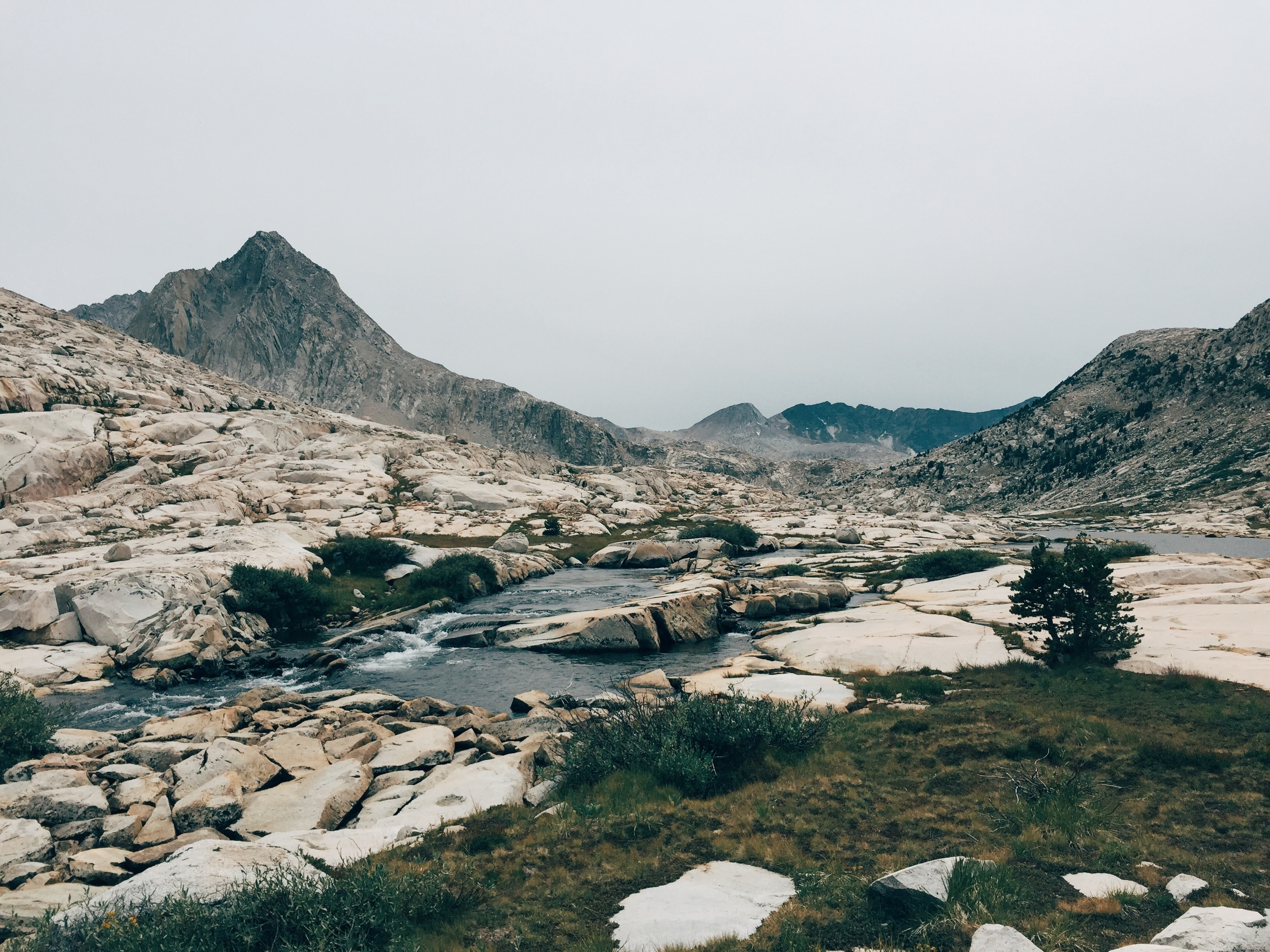 Hiking under gray skies in the jaw-dropping beauty of Evolution Valley.