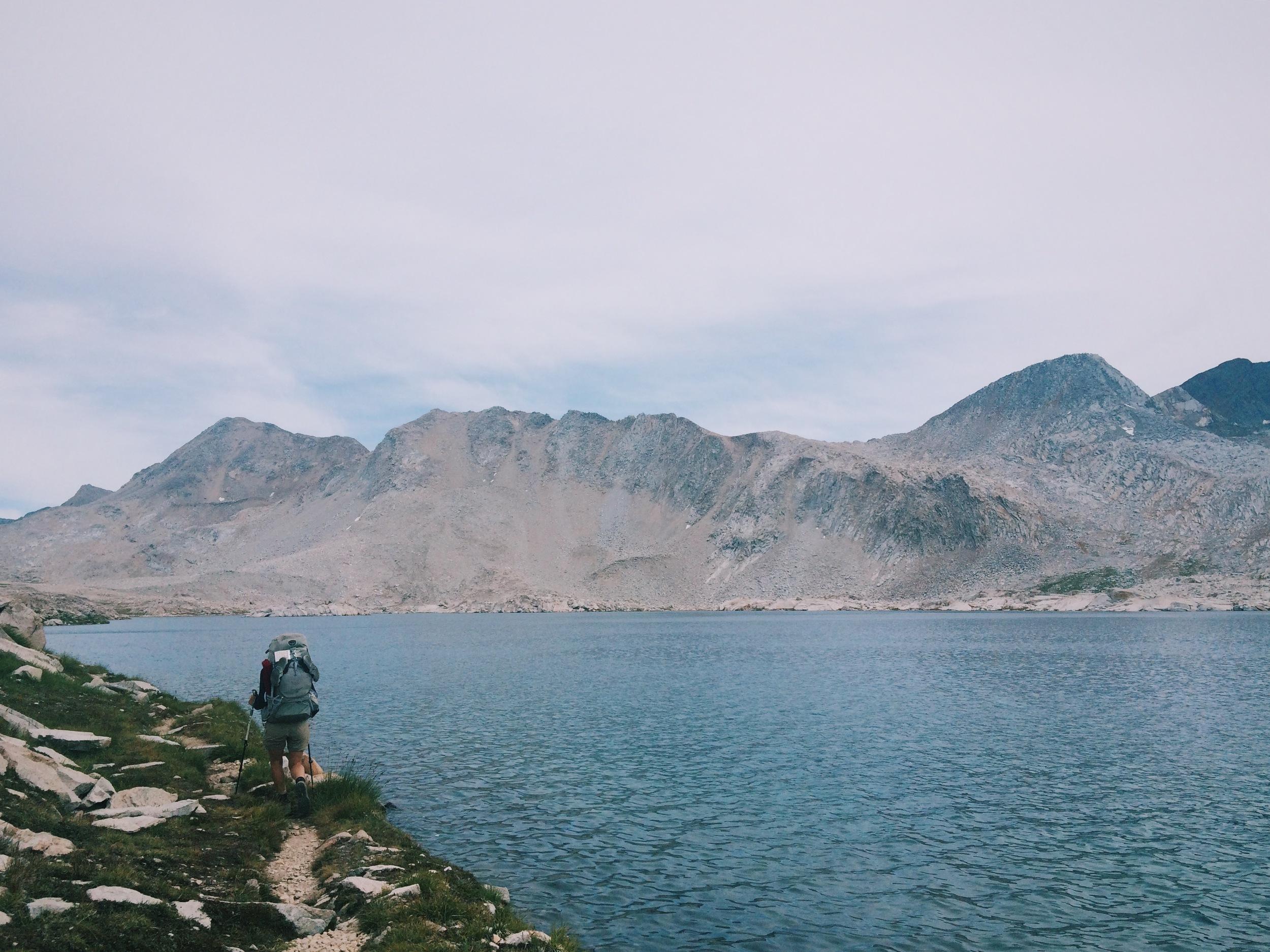 Hiking along the shore of Wanda Lake on the way to Muir Pass.
