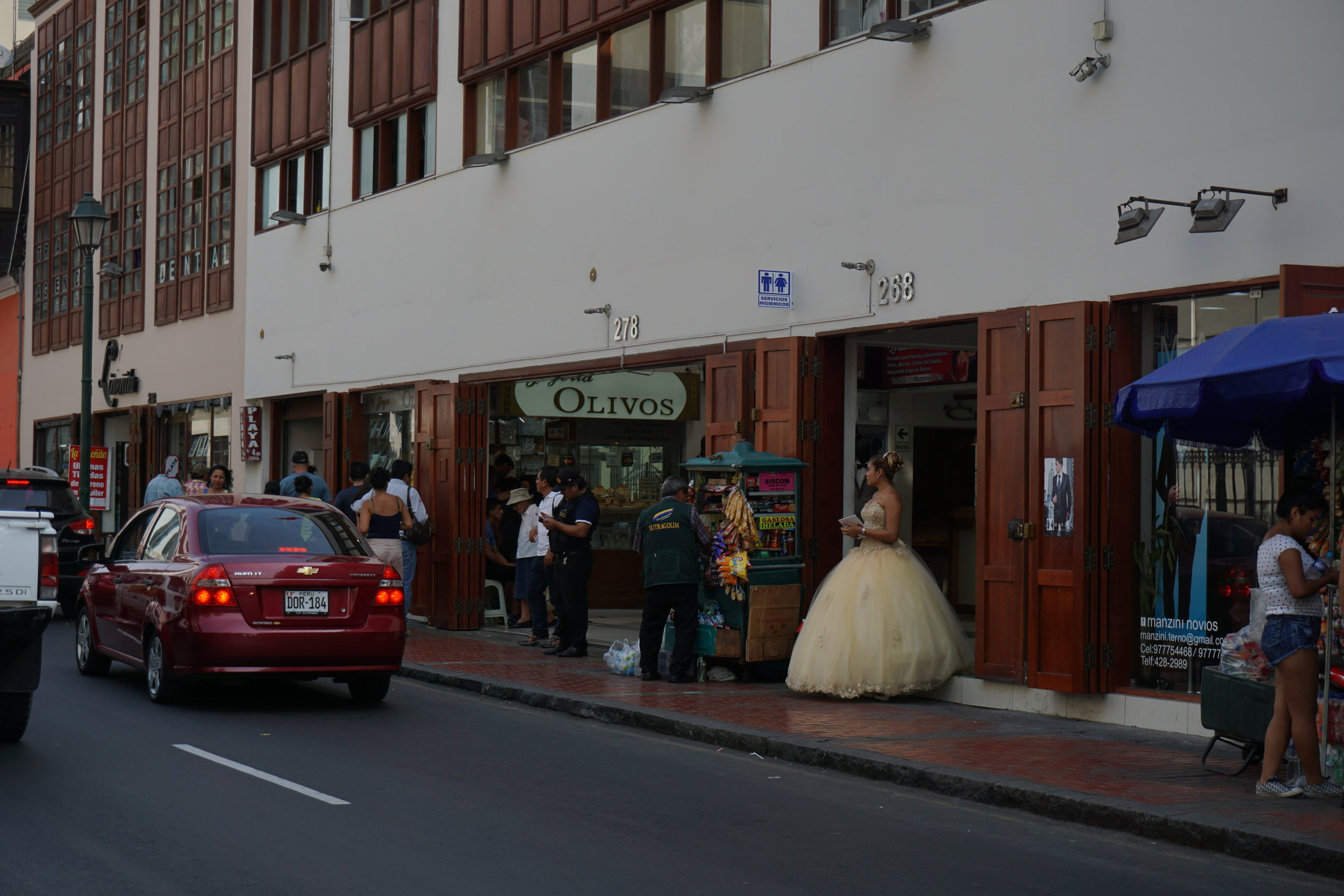 The odd sight of a vendor dressed as a princess amid the hustle and bustle of Lima's central district.