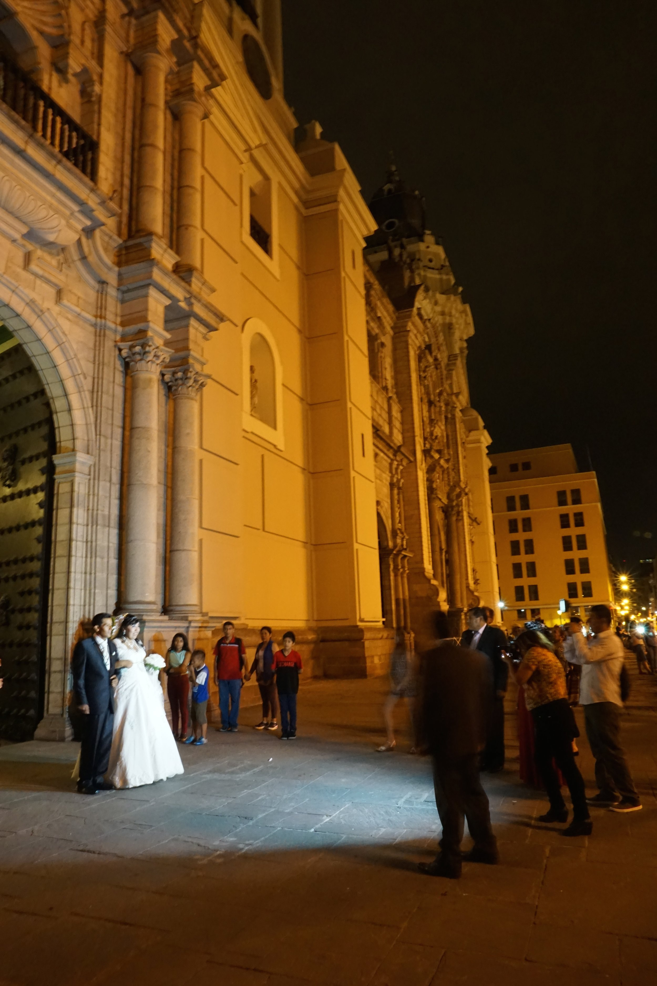 One of the many weddings happening on a weekend evening in Lima's cathedral.