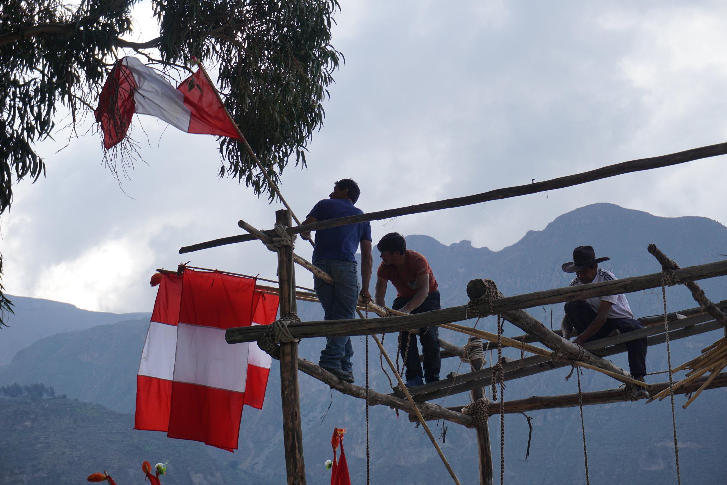Villagers preparing for the celebration of the Fiesta de la Virgen de Candelaria in the town square of Maca.