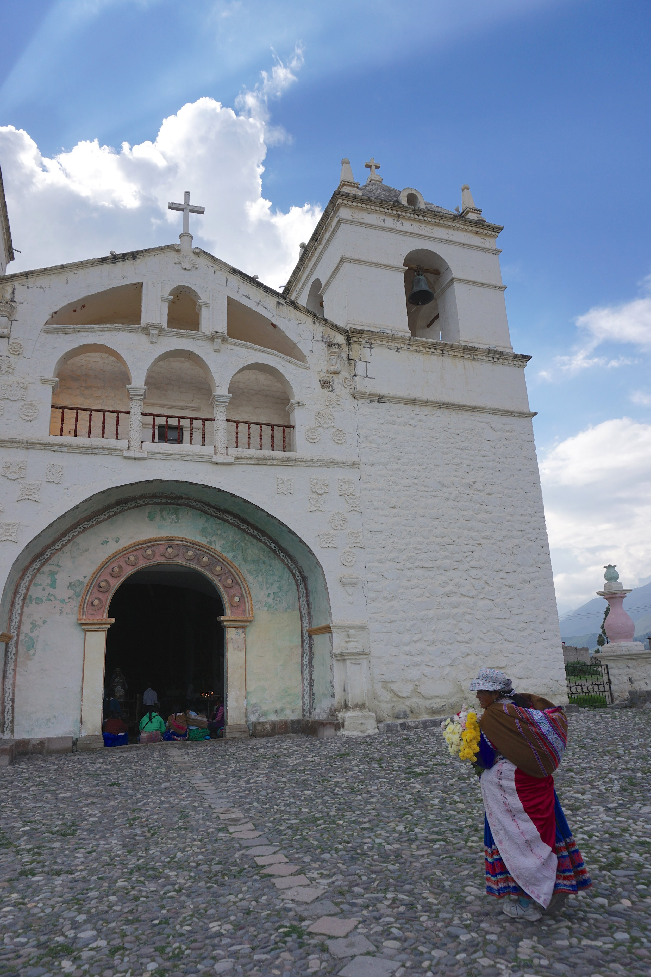 A local woman approaching the town church of Maca in the Colca Valley, on the eve of the Fiesta de la Virgen de Candelaria