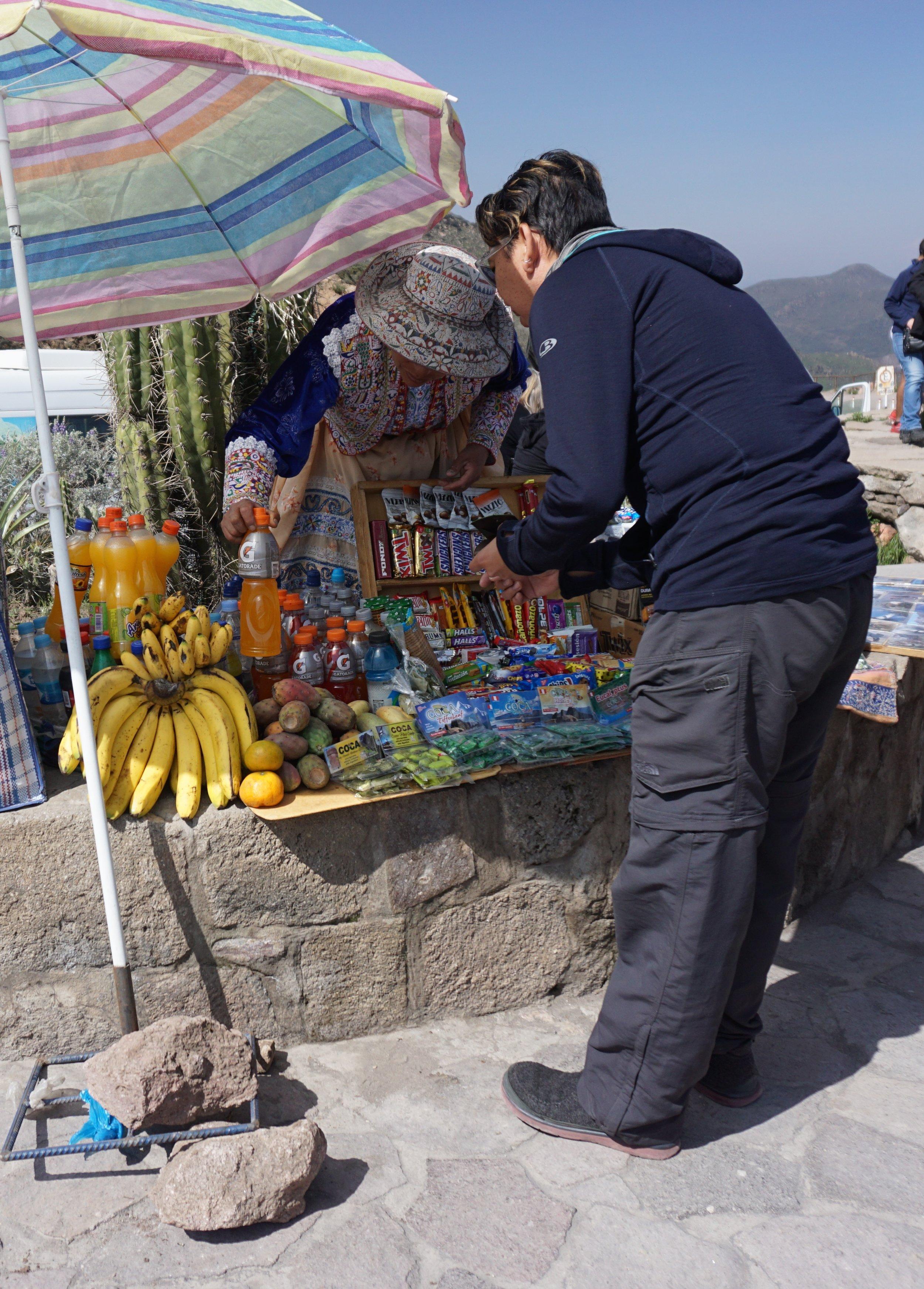 J wheeling and dealing with a vendor at Cruz del Condor