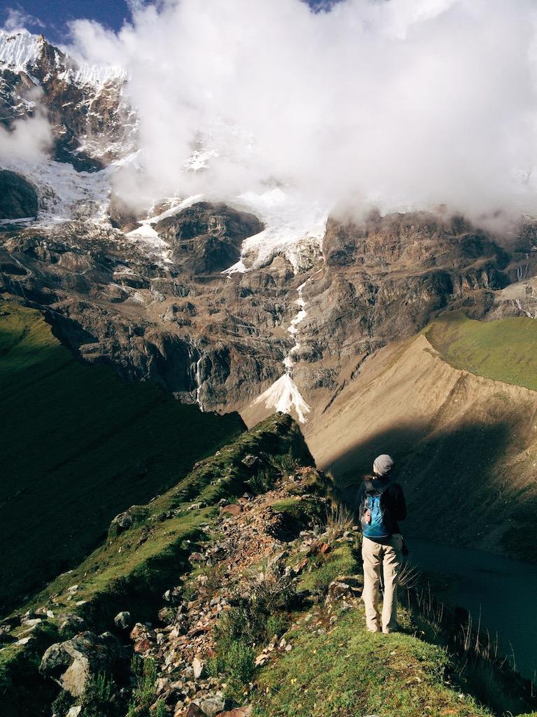 Atop a ridge between Humantay Lake and a verdant valley.