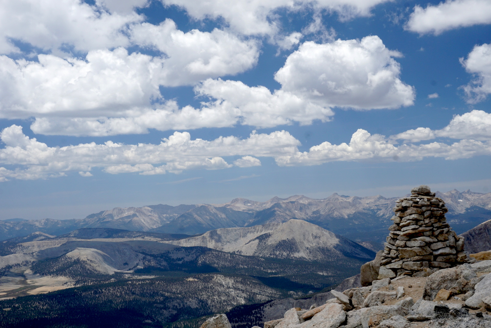 On the trail to Mt. Langley, an impressively-constructed wayfinding cairn and the breathtaking view into Sequoia National Park.