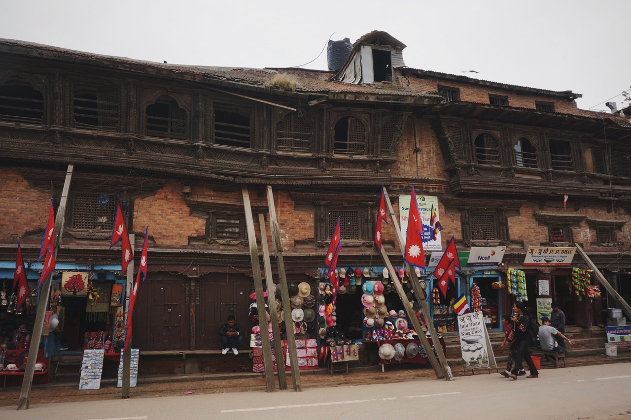 A historic building held up by beams and luck just outside of Bhaktapur's Durbar Square
