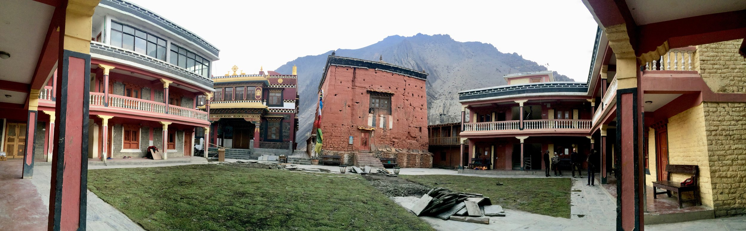 The Kag Chode Monastery complex includes the 500-year-old monastery building (at center) and newer buildings that serve as a monastic school for orphaned and impoverished boys. Monks in crimson red habit walk slowly and wisely, while rambunctious boys in crimson red track suits with saffron stripes play.