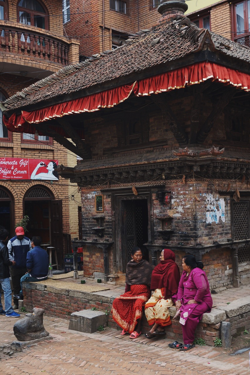 Three Nepali women catching up near Durbar Square
