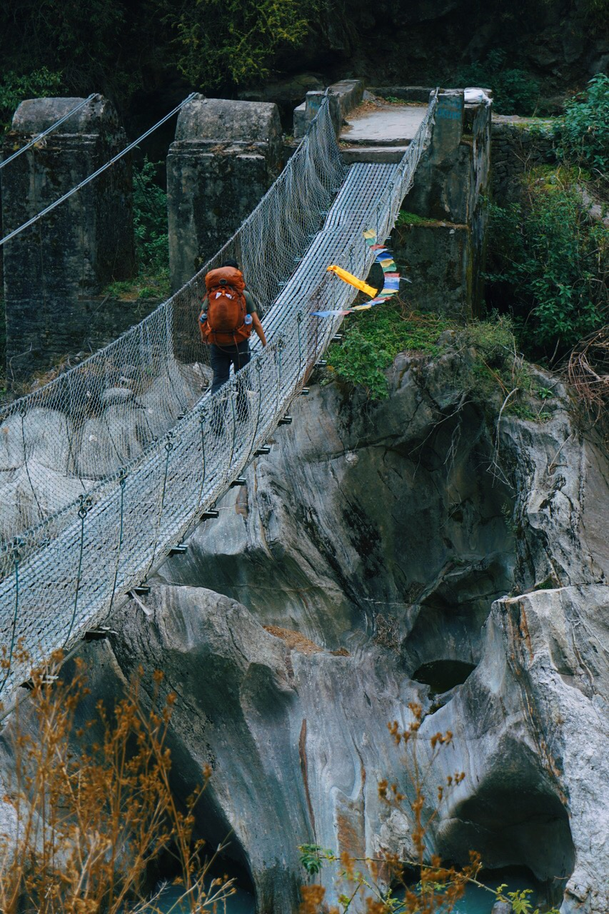 Crossing one of the many suspension bridges along the trek