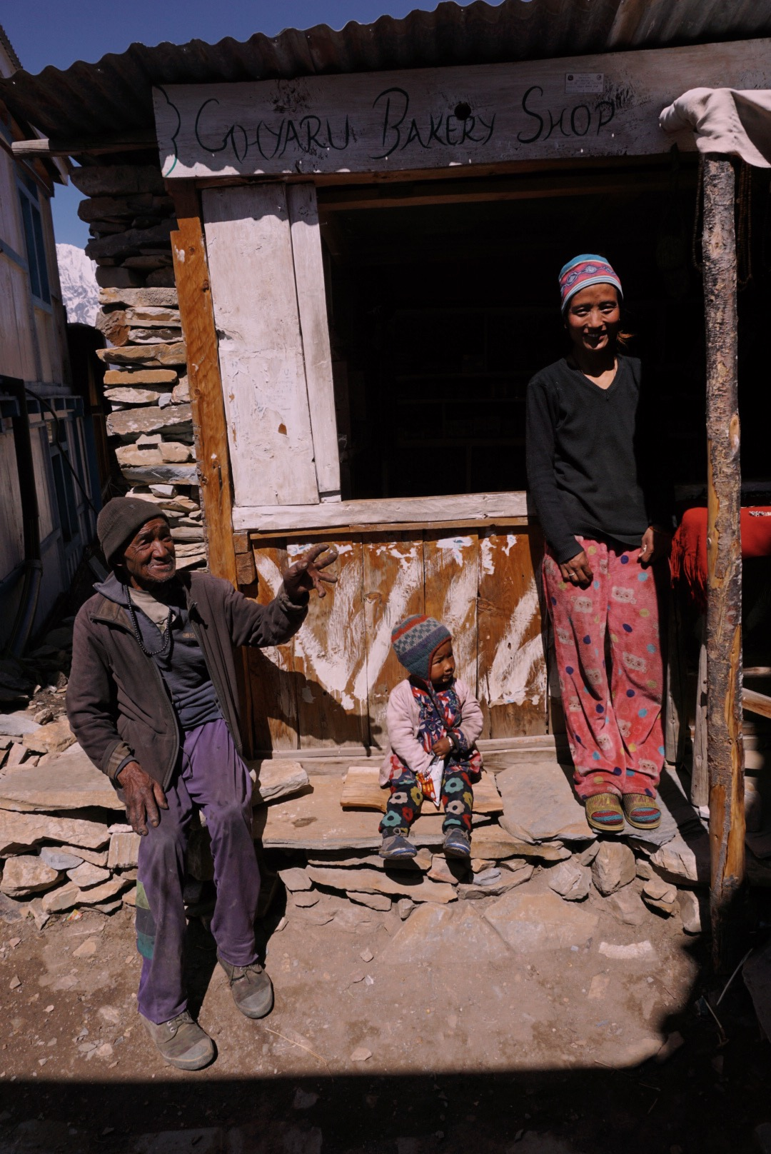Jewelry vendor Chantri with her son and father-in-law, village of Ghyaru