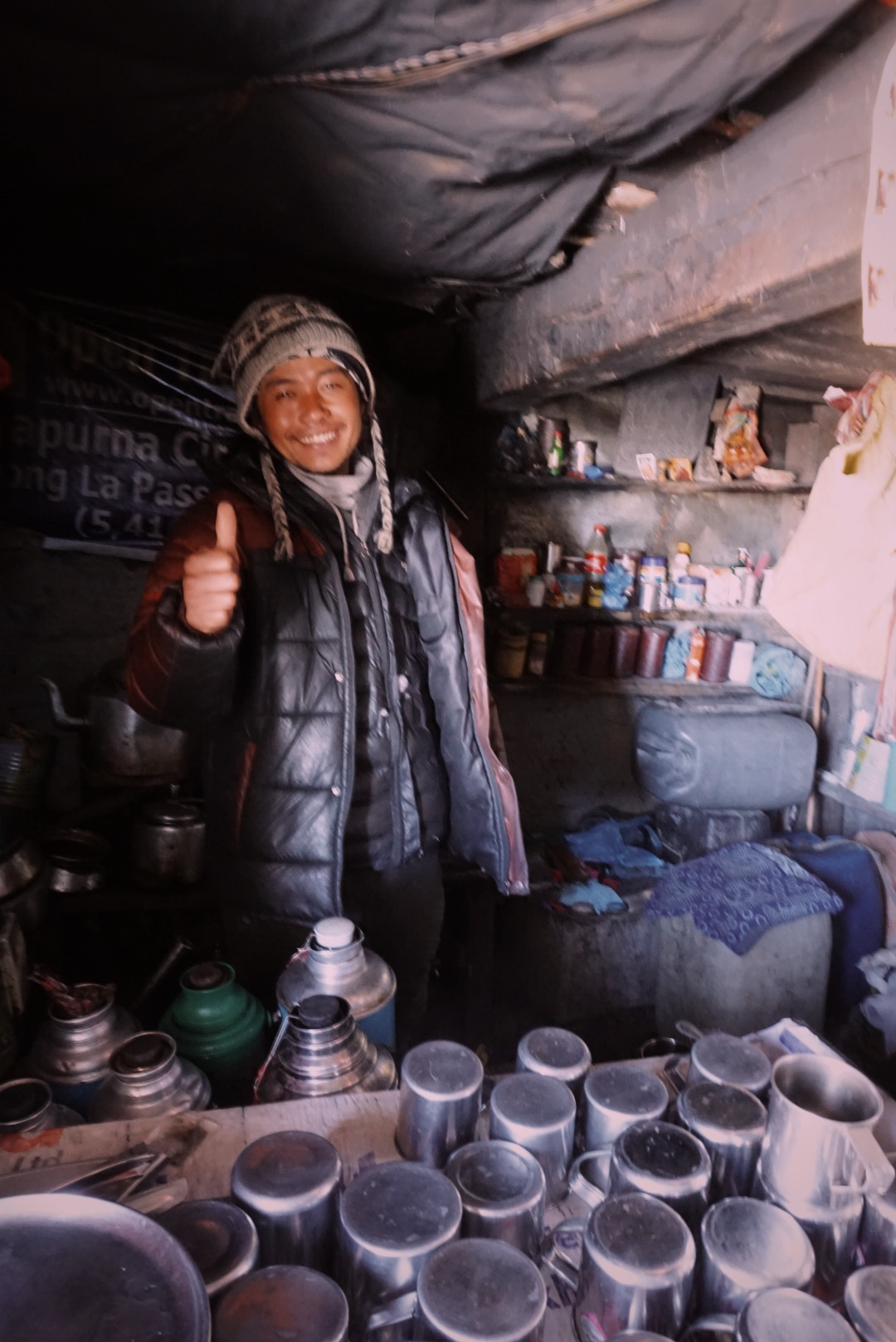 This is Sana. Four months out of every year he lives at Thorung La (5,416 m / 17,769 ft), serving tea and soup out of a small teahouse structure at the pass. Sometimes he hikes 1,000 feet below to have dinner with another lone teahouse operator, but word is Sana doesn't cook and lets his friend prepare the dal bhat instead.