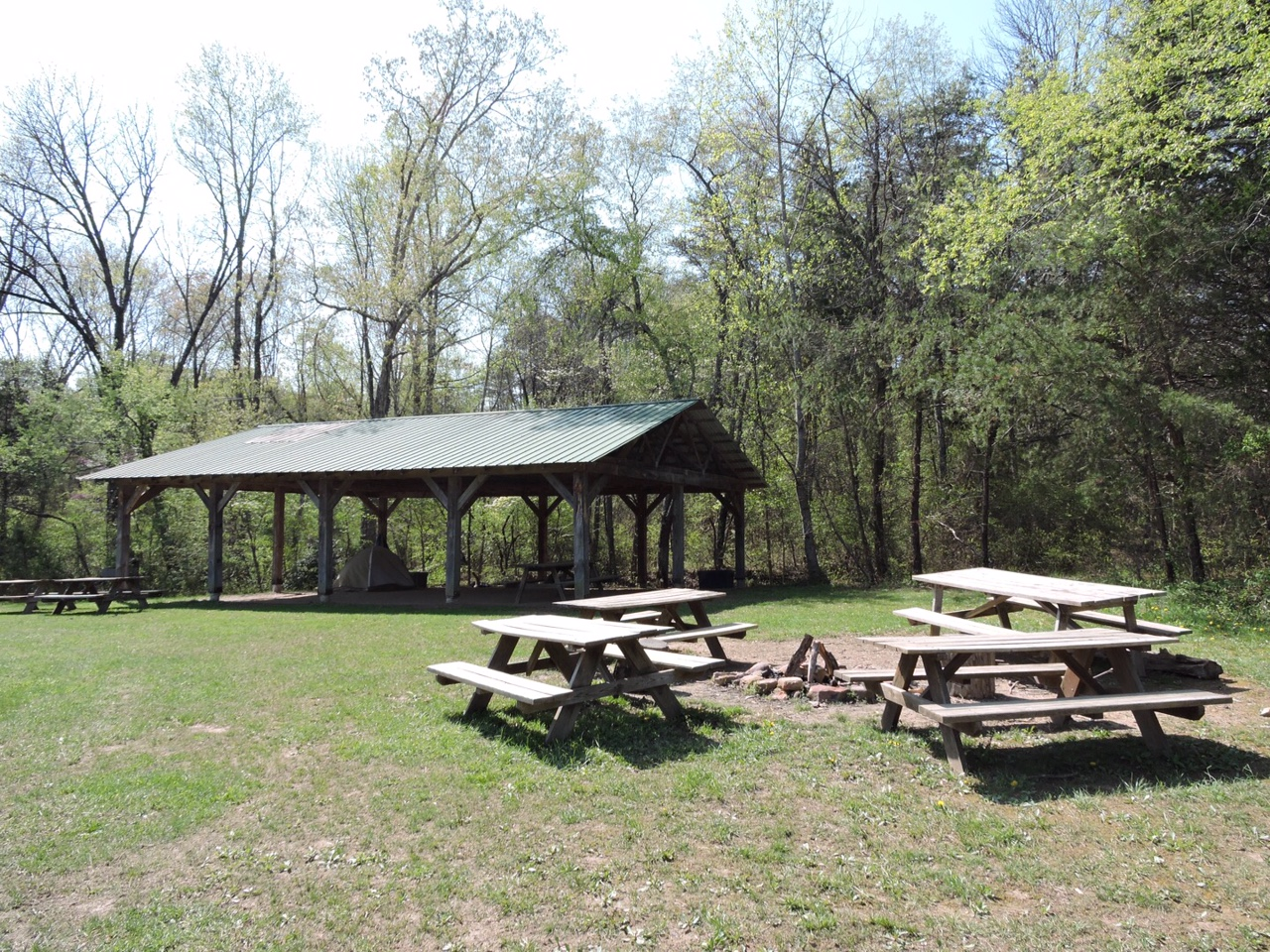 Accessible by a separate entrance to our property, is our largest campsite. It is equipped with a pavilion, large fire ring, camp grill, picnic table, and Port-a-Potties during the summer season. There is about a ten minute walk to thebathhouse, water pump, and the free Base Camp activities.  Nightly Fee: $50 plus $10 per person.
