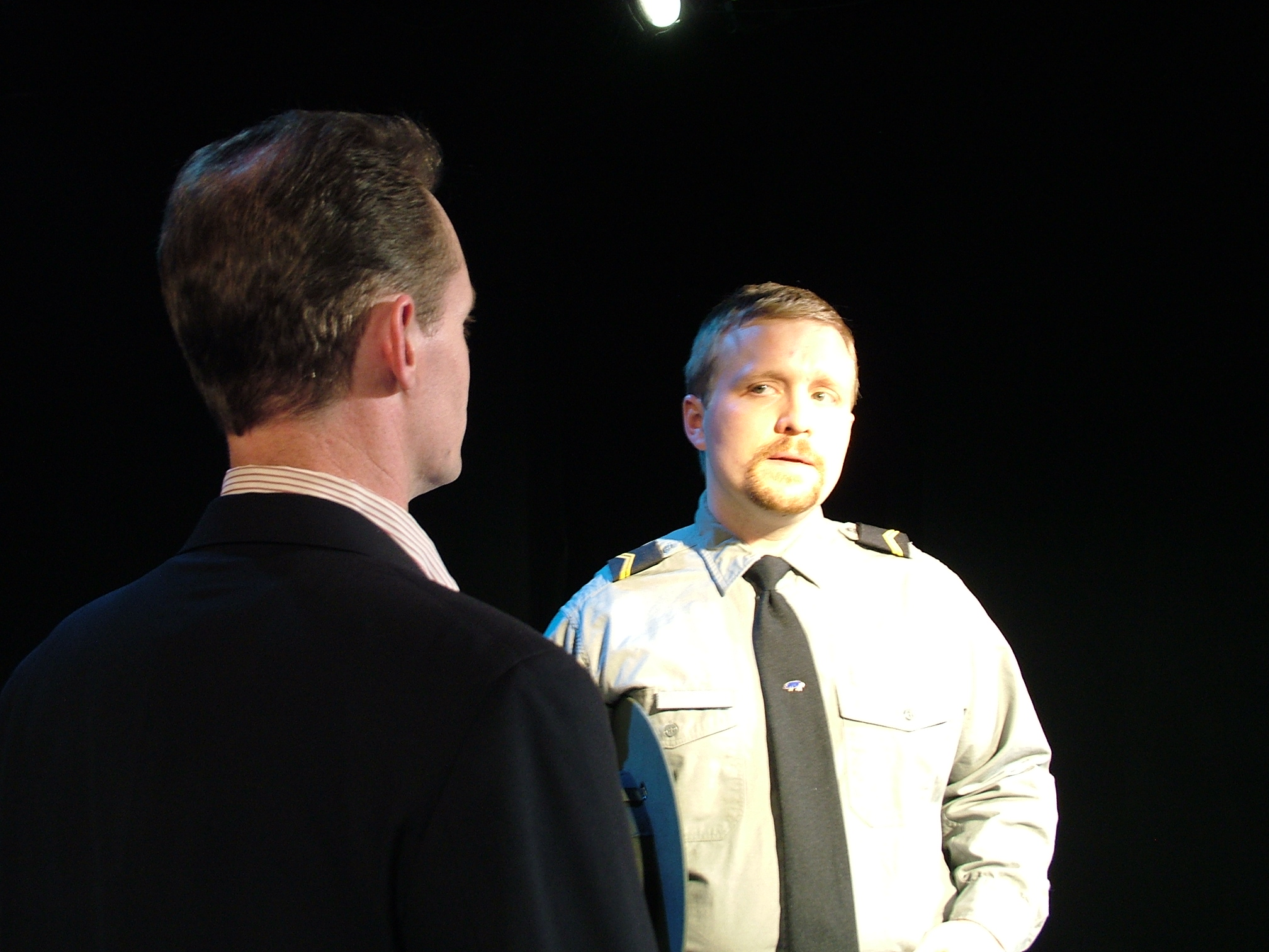 Tom Staggs and David DelGrosso as Gordon and Cop in When Is A Clock (2008)