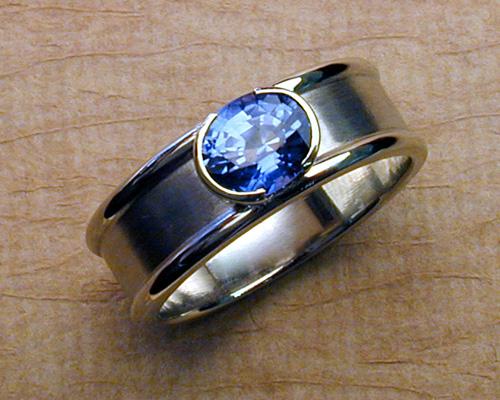 Split bezel blue sapphire band, 14k white gold.