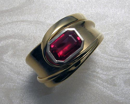 Fluid freeform band with ruby.