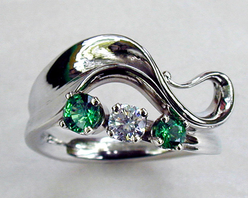 Wave-like freeform engagement ring.