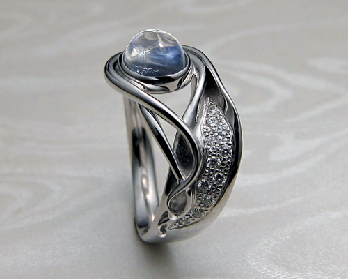 Contemporary, Art Nouveau style engagement ring with blue moonstone.