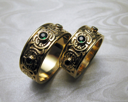 Celtic wedding bands, with green garnets.