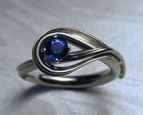 Fluid, freeform, blue sapphire engagement ring.