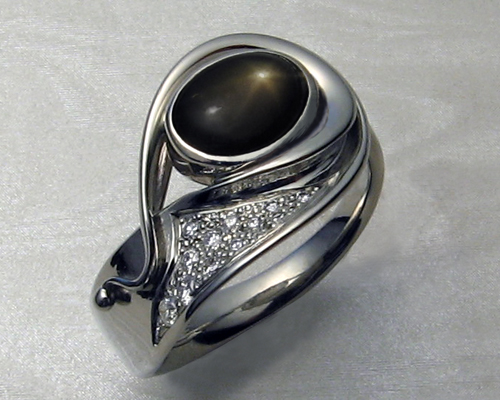 Fluid, organic, freeform, ladies ring with black star sapphire.