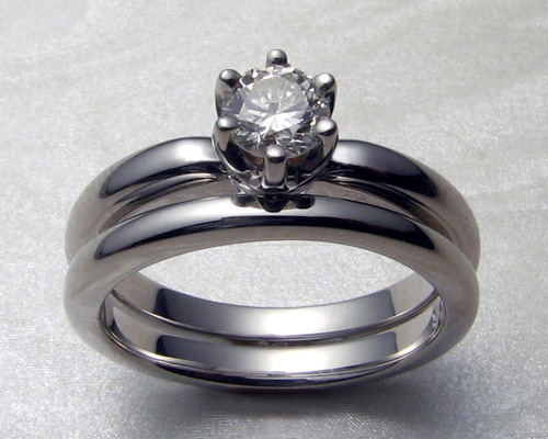 Solitaire engagement ring with matching band.