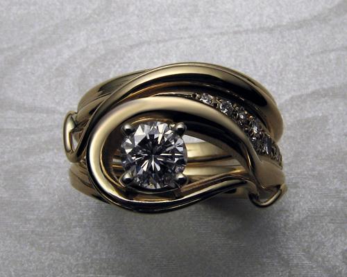 Fluid organic, free-form engagement ring set.
