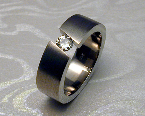 Tension set diamond band, with diagonal opening.