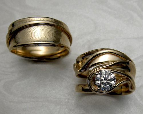 Free-form fingerprint band with matching engagement ring set.