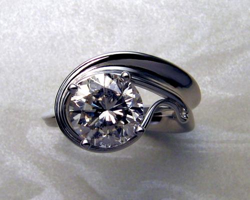 Unusual, asymmetrical engagement ring.