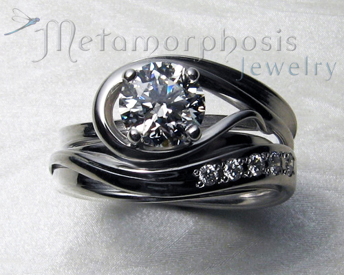 Very unusual custom made engagement ring with matching wedding band.